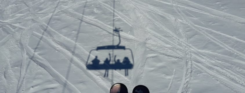skis chairlift shadow